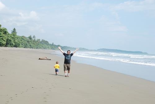 Todd with Lucas on deserted beach in Costa Rica