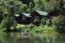 Beautiful view of Sueños del Bosque Lodge cabins and lake