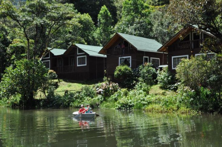 Beautiful view of Suenos del Bosque Lodge cabins and lake